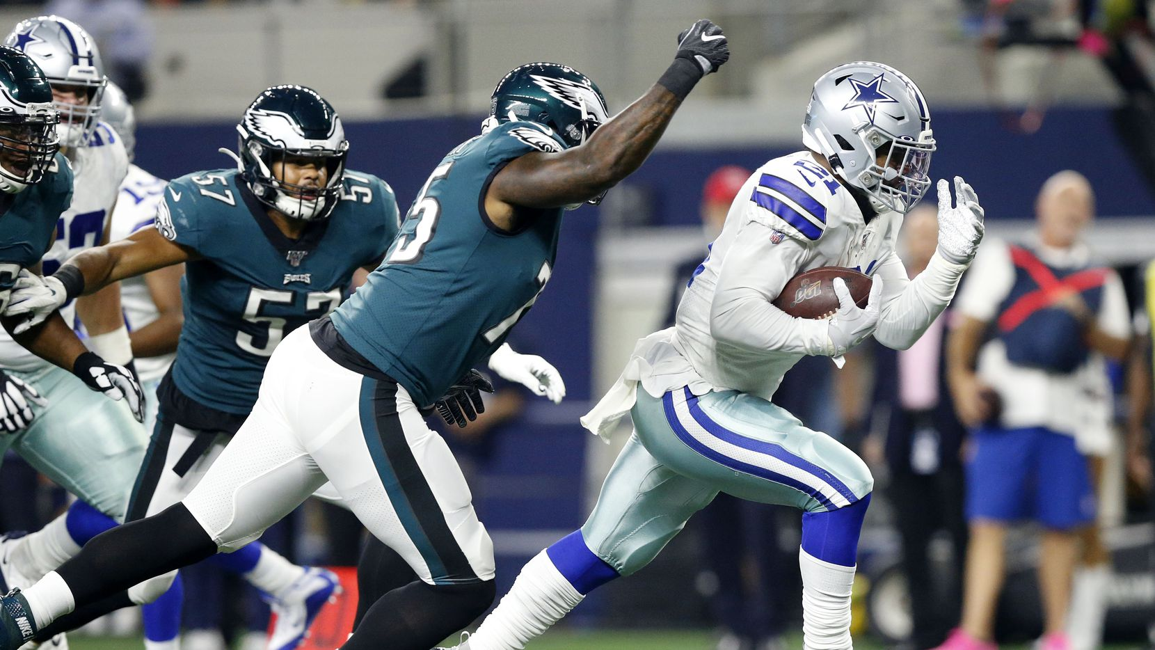 Dallas Cowboys running back Ezekiel Elliott (21) runs for a would be first quarter touchdown against Philadelphia Eagles defensive end Vinny Curry (75) at AT&T Stadium in Arlington, Texas, Sunday, October 20, 2019. Elliott's knee touchdown short of the line. He scored thereafter.