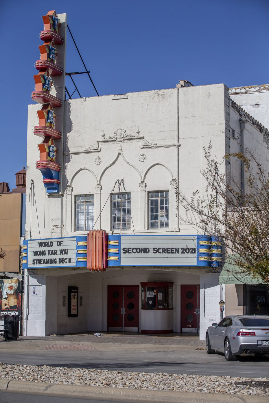 The marquee at the Texas Theatre touts the renovation plans.