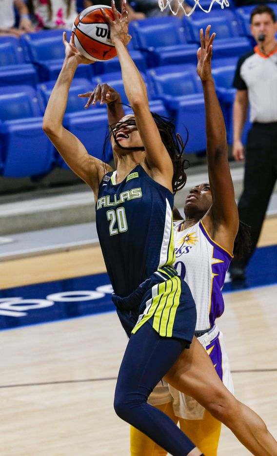 Dallas Wings forward Isabelle Harrison (20) goes for a shot in the second quarter against the Los Angeles Sparks at College Park Center on Tuesday, June 1, 2021, in Arlington. (Juan Figueroa/The Dallas Morning News)