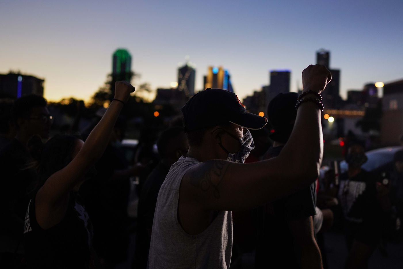 Protesters march against police brutality as they depart a rally at the Dallas Police Headquarters on Friday, May 29, 2020, in Dallas.