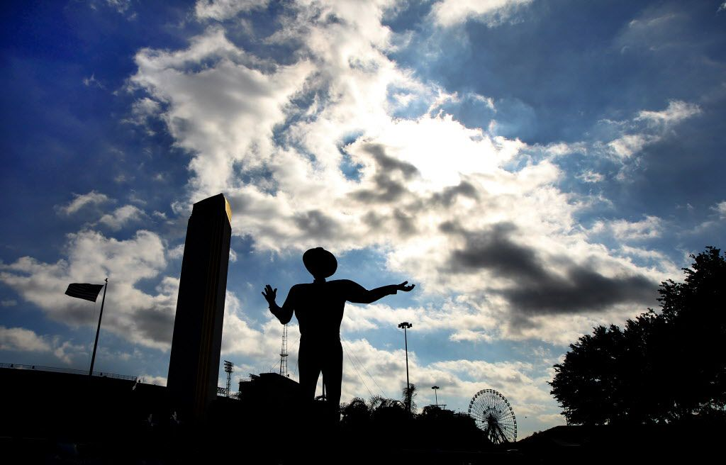 Big Tex is silhouetted against the early morning sky on October 17, 2012.