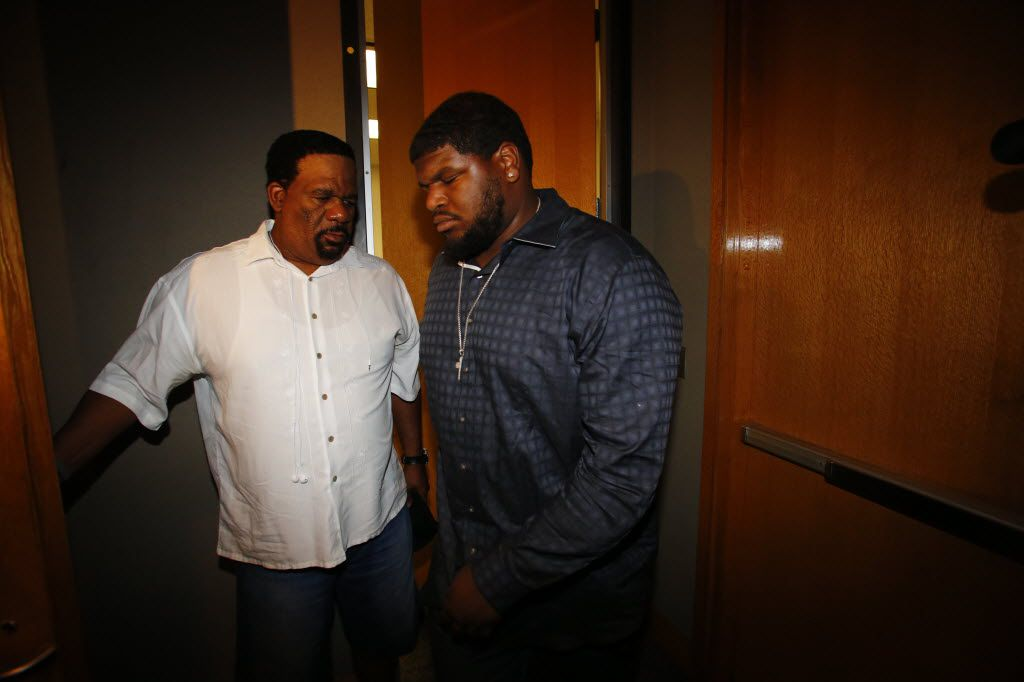 David Wells (left) accompanied Josh Brent for a court hearing in the intoxication manslaughter case against the troubled Cowboys lineman.