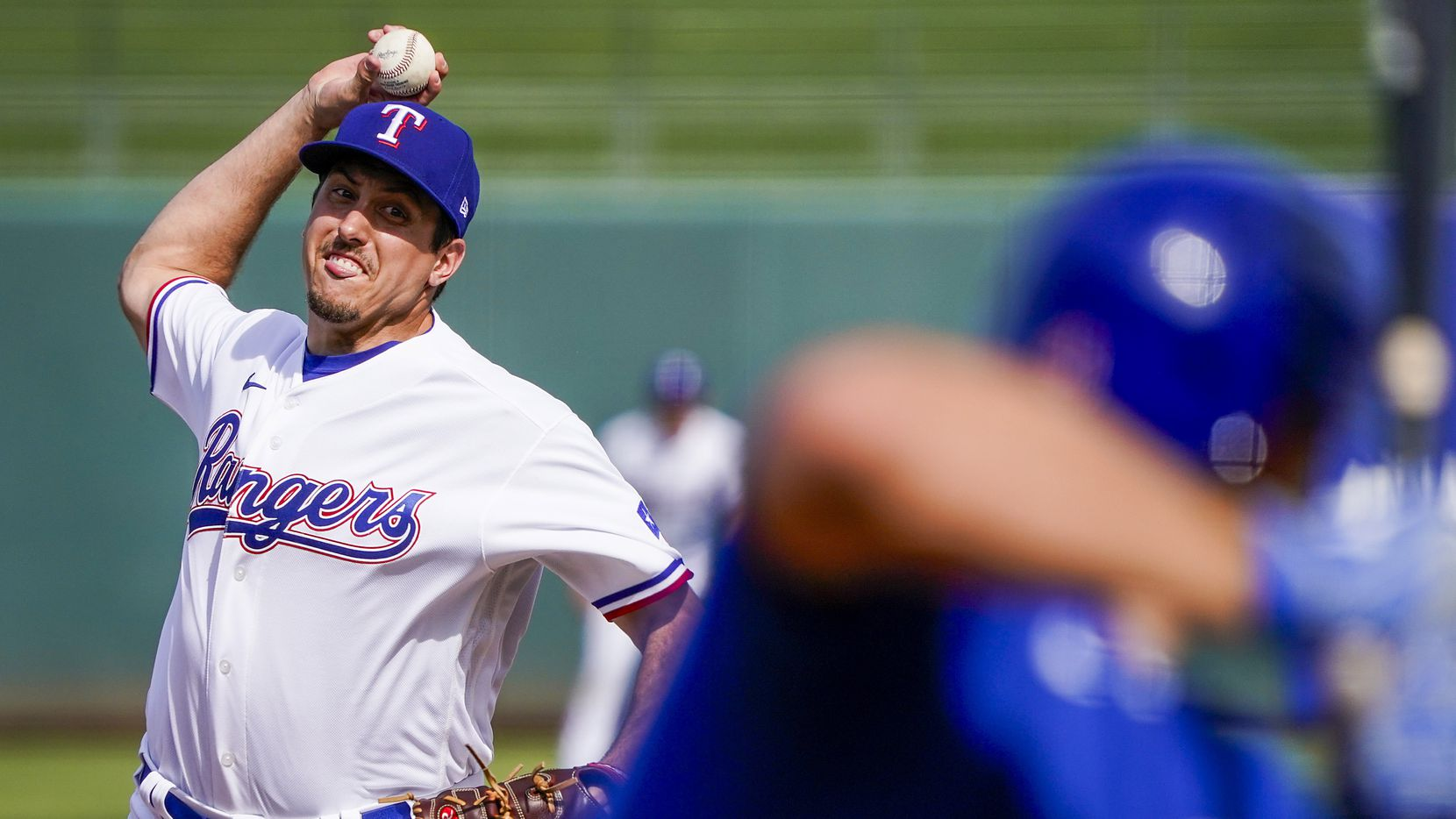 Texas Rangers pitcher Derek Law pitches during the third inning of a spring training game against the Chicago Cubs at Surprise Stadium on Thursday, Feb. 27, 2020, in Surprise, Ariz.