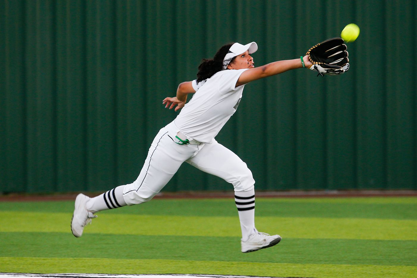Denton Guyer's Tehya Pitts (8) catches a ball in the outfield from Keller during the second inning of a nondistrict softball game in Denton on Tuesday, March 30, 2021. (Juan Figueroa/ The Dallas Morning News)