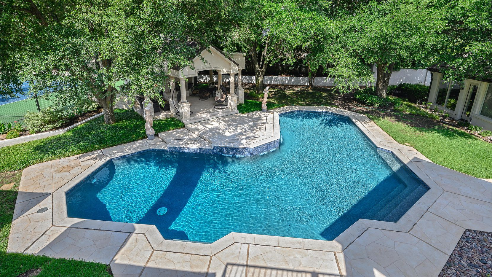 Priced at $3,375,000, the estate at 5600 Cradlerock Circle in the Willow Bend Country community features a diving pool, play yard and tennis court.