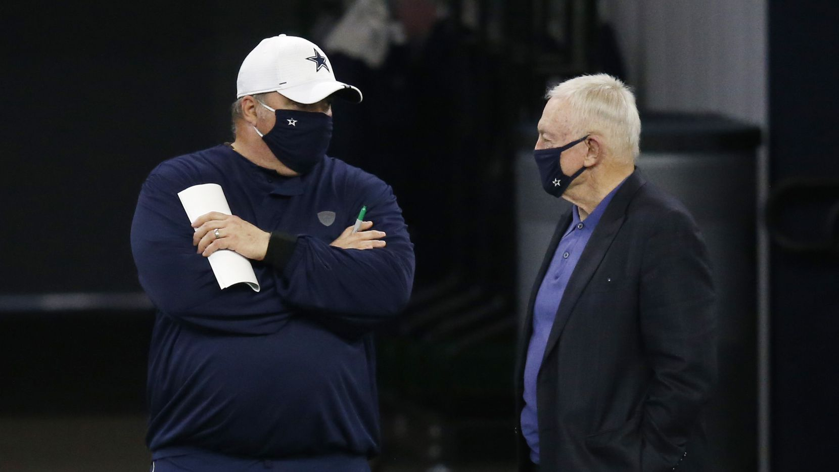 Dallas Cowboys head coach Mike McCarthy talks to Dallas Cowboys owner and general manager Jerry Jones on the sidelines in practice during training camp at the Dallas Cowboys headquarters at The Star in Frisco, Texas on Monday, August 31, 2020.