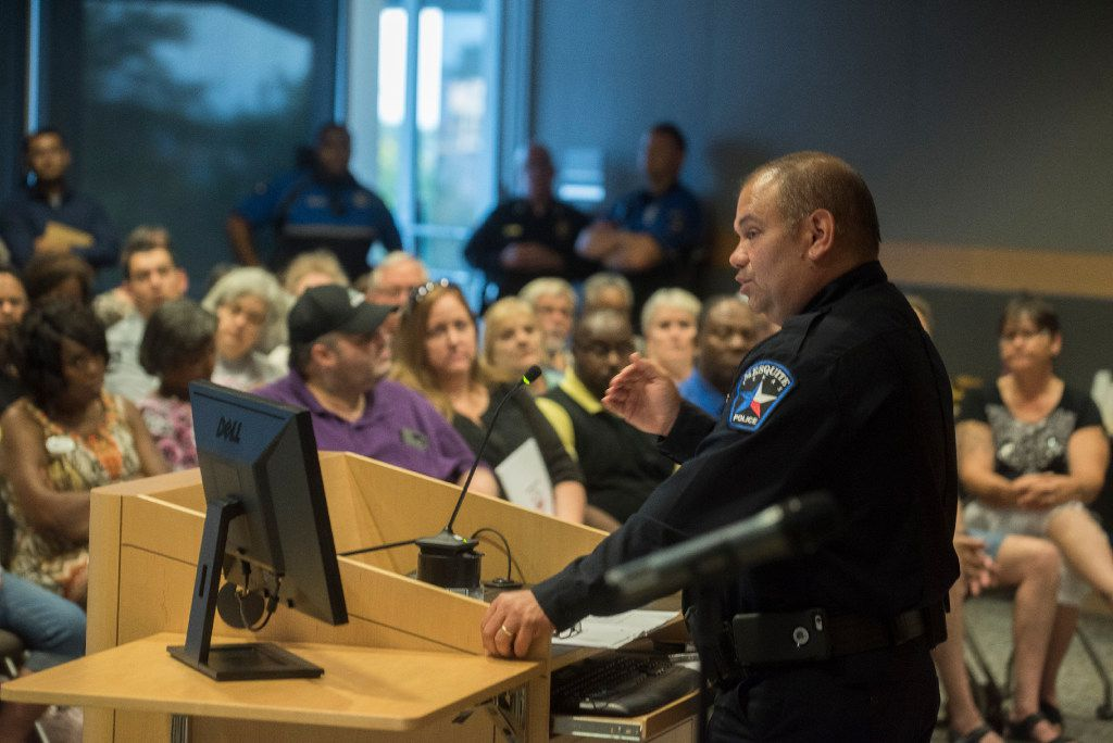 """Mesquite Police Chief Charlie Cato discusses crime prevention with residents during a town hall meeting on community policing in September 2016. The department recently added a """"20-4-7"""" program as a tool for getting residents involved   (Rex C. Curry/Special Contributor)"""
