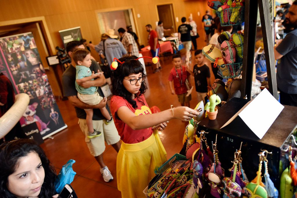 Jessica Trevizo, 29, wears El Chapulin Colorado costume during the Texas Latino Comic Con at the Latino Cultural Center in Dallas, Saturday, July 29, 2017. The superhero El Chapulin Colorado meaning The Red Grasshopper was a popular Mexican comedy show in the 1970s and early 80s.