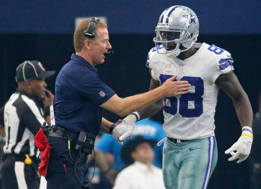 FILE - Dallas head coach Jason Garrett congratulates Dez Bryant (88) after a Dallas score during the Green Bay Packers vs. the Dallas Cowboys NFL football game at AT&T Stadium in Arlington, Texas on Sunday, October 8, 2017. (Louis DeLuca/The Dallas Morning News)