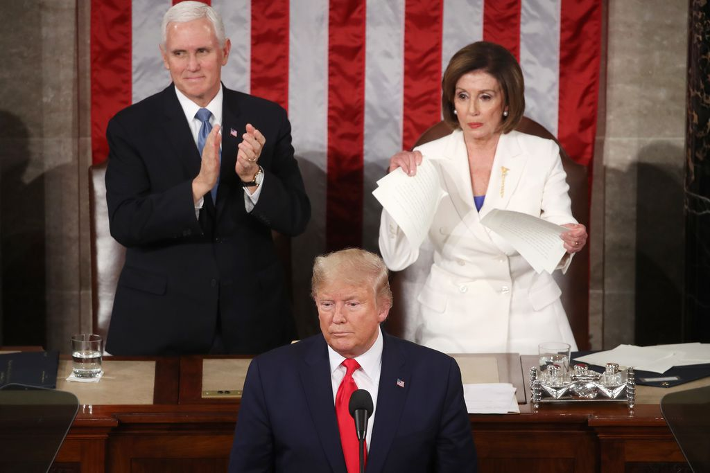 House Speaker Nancy Pelosi rips up pages of the State of the Union speech after President Donald Trump finishes delivering it Feb. 4, 2020.