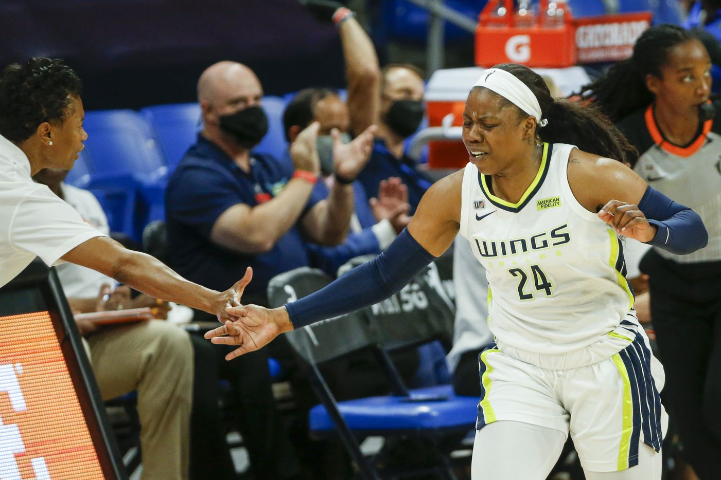 Dallas Wings guard Arike Ogunbowale (24) celebrates a three-point shot with head coach Vickie Johnson during the first quarter against the Washington Mystics at College Park Center on Saturday, June 26, 2021, in Arlington. (Elias Valverde II/The Dallas Morning News)