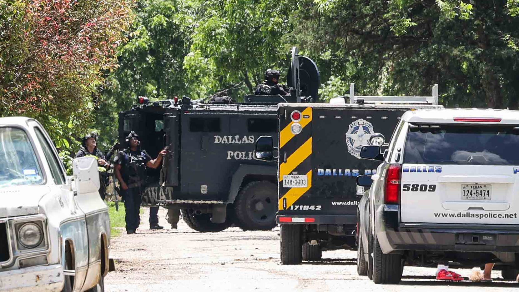 Authorities were in a standoff in east Oak Cliff with a murder suspect who shot at police in the 4500 block of Humphrey Drive on Wednesday.