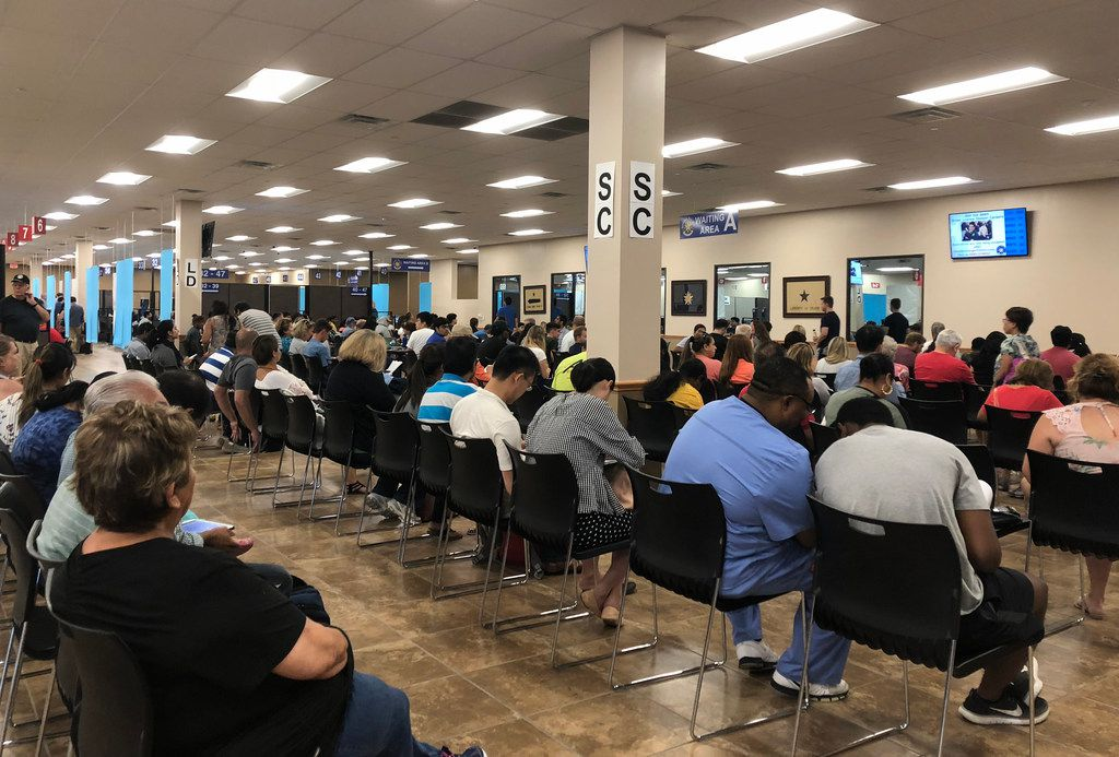Long lines form at the Texas Department of Public Safety driver license mega center in Carrollton, on Friday, August 3, 2018.