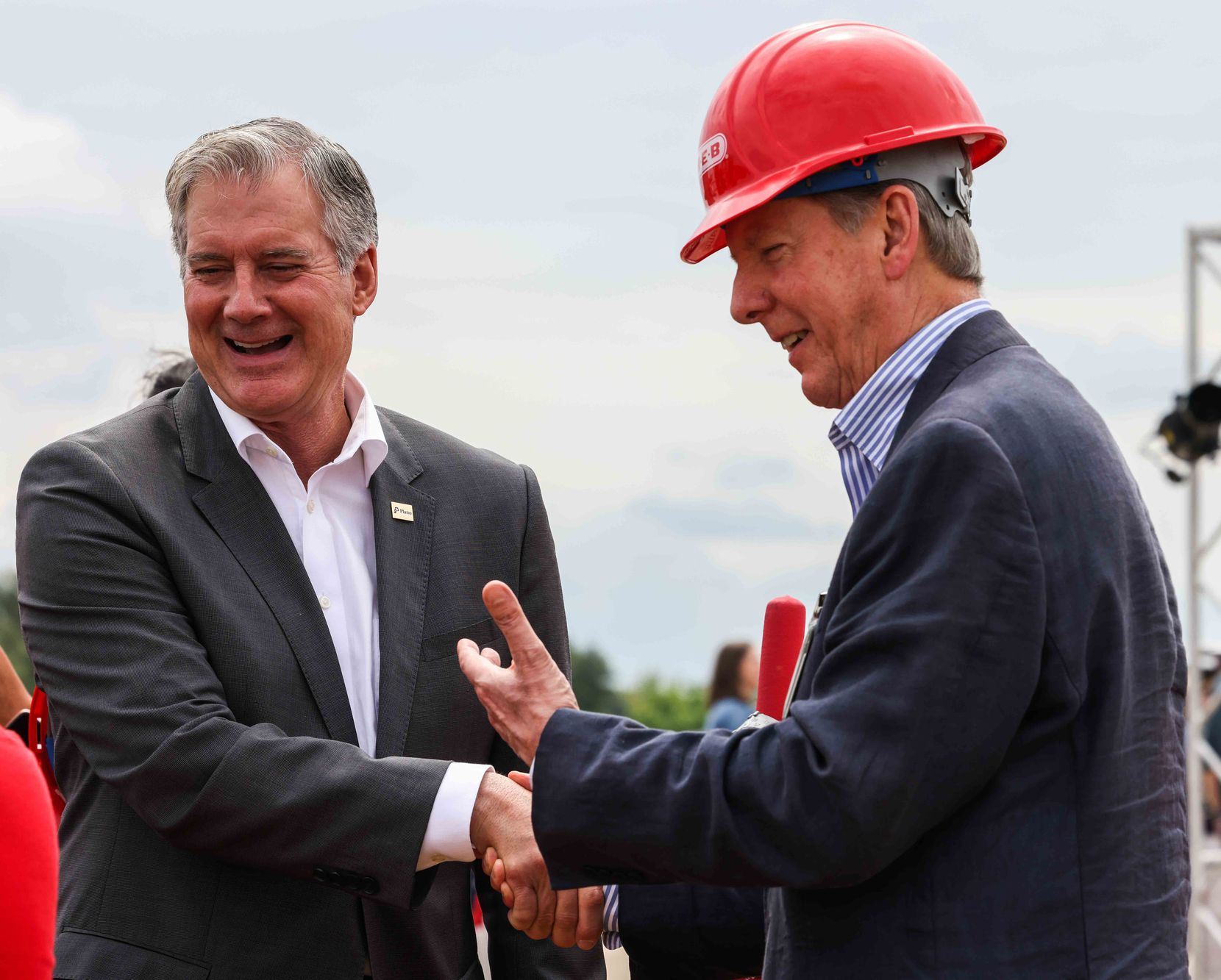 Plano Mayor John Muns and Central Market president Stephen Butt shake hands at the groundbreaking ceremony for the H-E-B store in Plano.