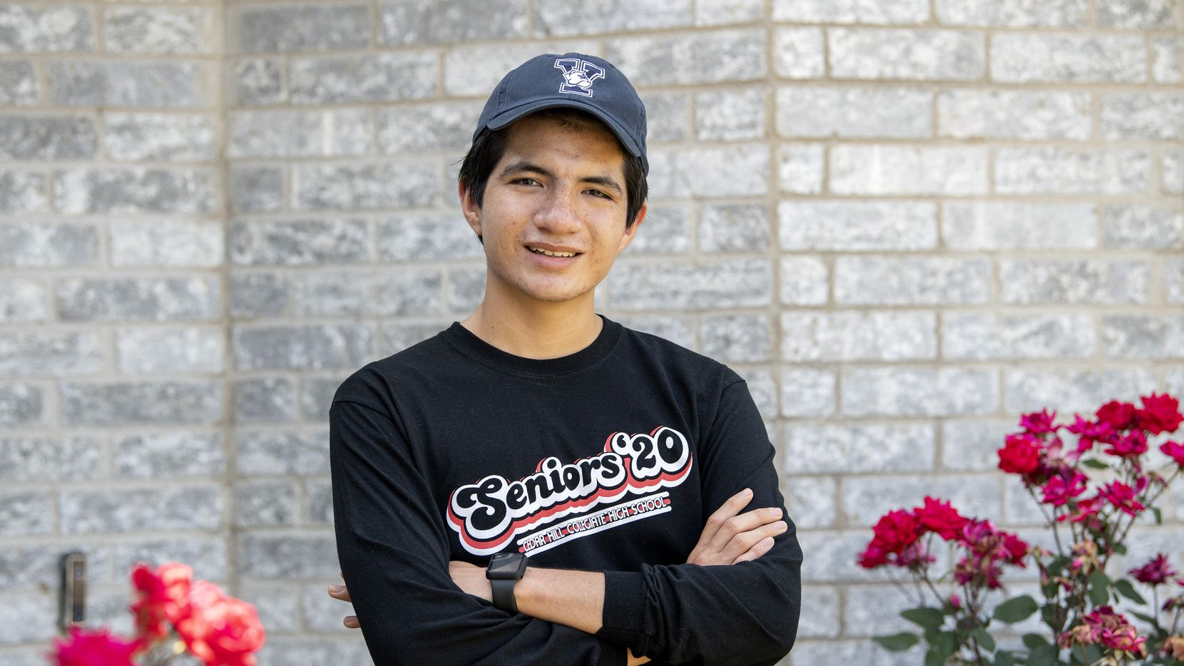 Richard Cardoso, an 18-year-old senior at Cedar Hill Collegiate High School, poses for a portrait in front of his home on May 7, 2020 in Cedar Hill, Texas. Graduating in the midst of the coronavirus pandemic, Cardoso plans to attend Yale and major in physics and philosophy and ultimately become an attorney to help people who immigrate to the United States, like his parents did in the 1980s.