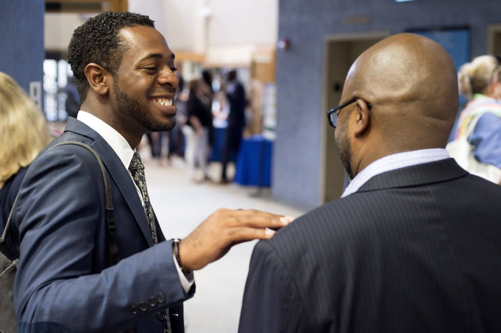 Dallas educators Byron Sanders and Nakia Douglas chat before Actions Speak Louder, a forum on race relations hosted by the Dallas Festival of Ideas on Friday, July 29, 2016 at El Centro College in downtown Dallas. (Jeffrey McWhorter/Special Contributor)