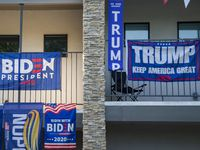 Neighbors in a two-story apartment have competing Biden and Trump banners draped over their balconies at the corner of Anita Street and Greenville Avenue in East Dallas Friday, Sept. 25, 2020 . (Juan Figueroa/ The Dallas Morning News)