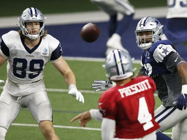 Dallas Cowboys tight end Blake Jarwin (89) watches as quarterback Dak Prescott (4) passes the ball during training camp at The Star in Frisco, Texas on Monday, August 24, 2020.