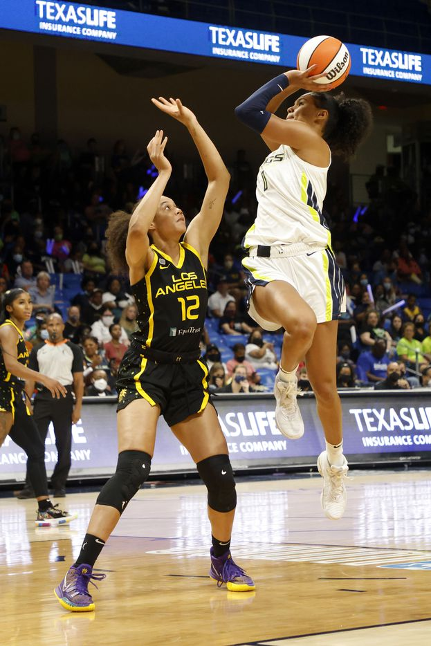 Dallas Wings forward Satou Sabally (0) makes a basket as she is defended by Los Angeles Sparks forward Nia Coffey (12) during the second half of a WNBA basketball game in Arlington, Texas on Sunday, Sept. 19, 2021. (Michael Ainsworth/Special Contributor)