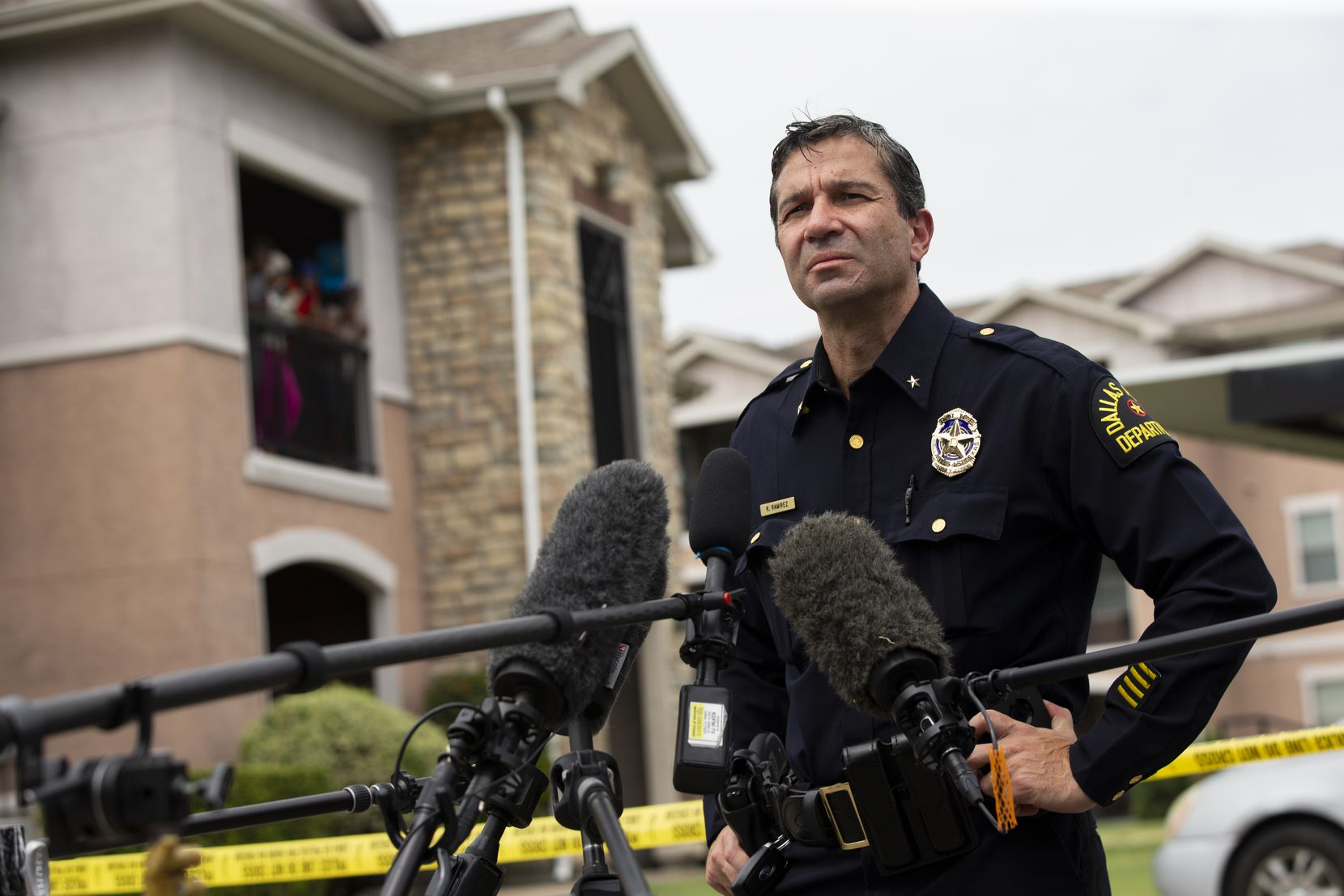 Dallas Police Deputy Chief Reuben Ramirez spoke to the press at the scene of a possible triple homicide at the Rosemont at Ash Creek apartments on Aug. 31 in East Dallas. (Juan Figueroa/The Dallas Morning News)