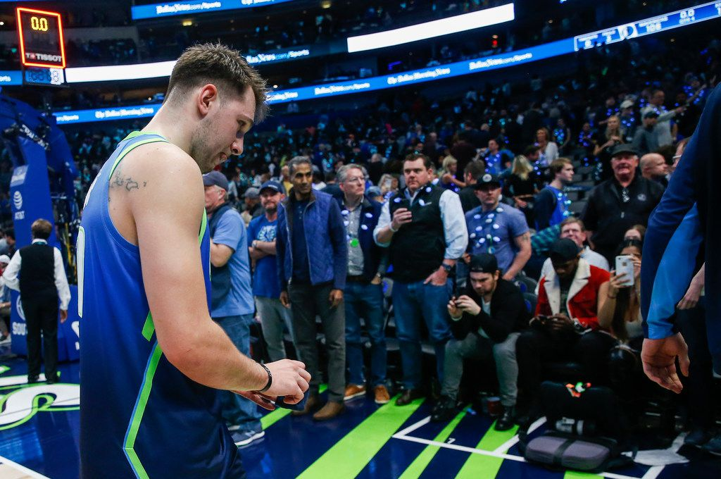 Dallas Mavericks forward Luka Doncic (77) exits the court following a loss to the Sacramento Kings on Sunday, Dec. 8, 2019 at American Airlines Center in Dallas. (Ryan Michalesko/The Dallas Morning News)