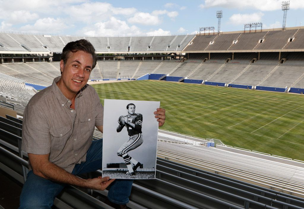 Michael Meredith, an independent film director, screenwriter and producer, with a photograph of his dad, Don Meredith,  at the Cotton Bowl.  (David Woo/The Dallas Morning News)