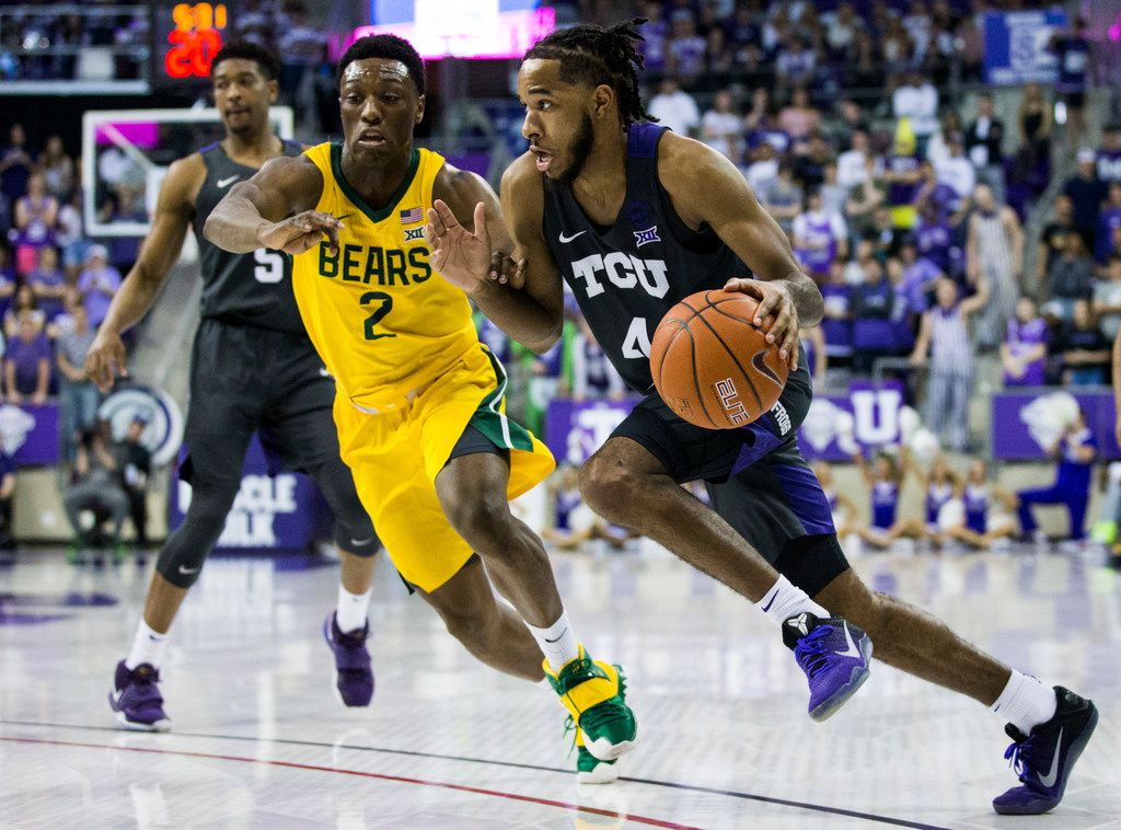 TCU Horned Frogs guard PJ Fuller (4) gets around Baylor Bears guard Devonte Bandoo (2) during the second half of an NCAA mens basketball game between Baylor and TCU on Saturday, February 29, 2020 at Ed & Rae Schollmaier Arena on the TCU campus in Fort Worth. (Ashley Landis/The Dallas Morning News)