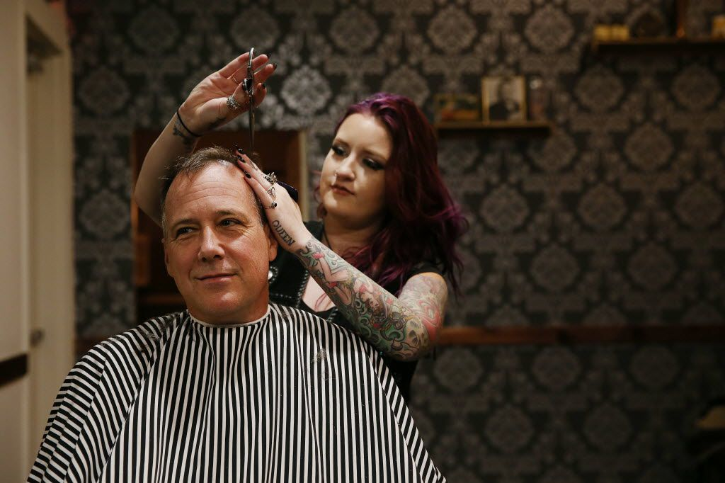 Barbershop manager Lindsey Zenker cuts the hair of Ken Erickson, of Austin, inside High & Tight.