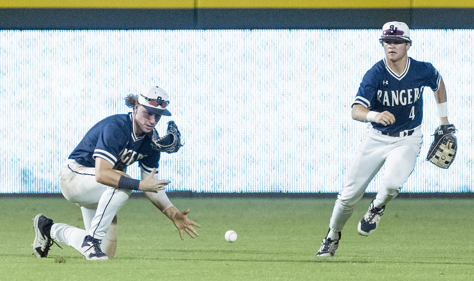 A hit by Rockwell-Heath Alex Stowers, (2), falls next to Comal Smithson Valley Kevin Bazzell, (9), as Jett Williams, (4), races into help on the play during the third inning of the 2021 UIL 6A state baseball semifinals held, Friday, June 11, 2021, in Round Rock, Texas.    (Rodolfo Gonzalez/Special Contributor)
