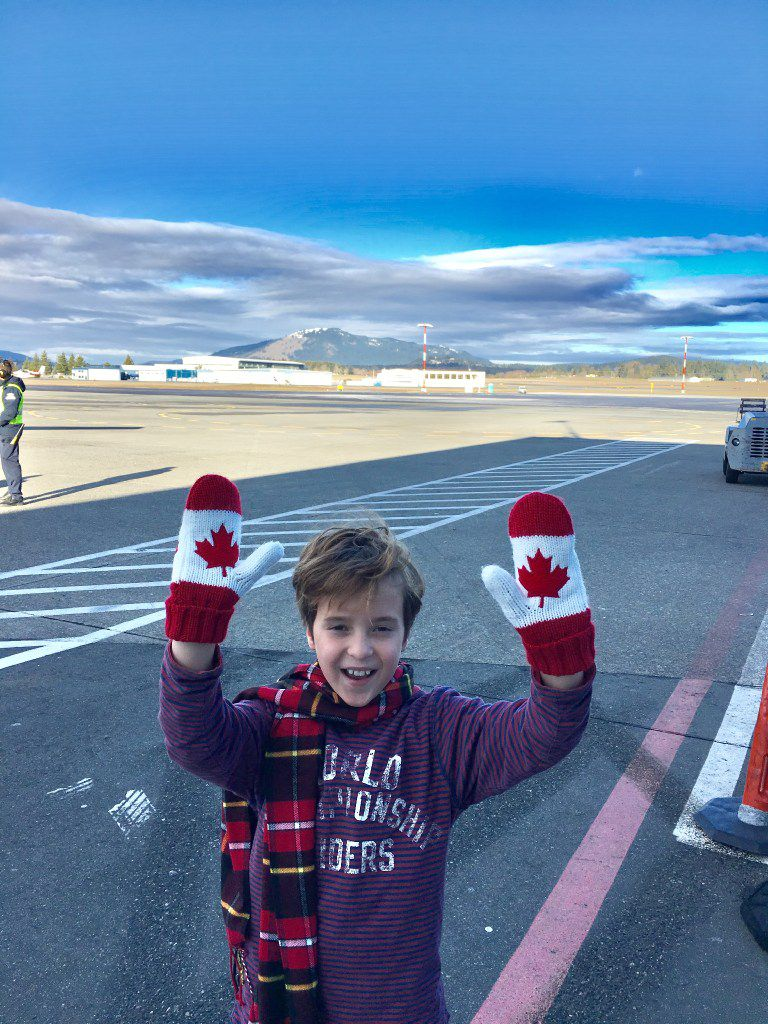 Doug Wilson, 9, wearing gloves with the Canadian flag.