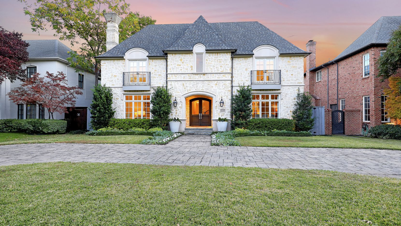 A traditional design can be found at 3229 Marquette St. in University Park, which features a stone-paved circular driveway.