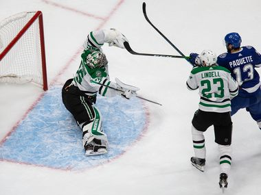 Goaltender Anton Khudobin (35) of the Dallas Stars makes a save against Cedric Paquette (13) of the Tampa Bay Lightning during Game One of the Stanley Cup Final at Rogers Place in Edmonton, Alberta, Canada on Saturday, September 19, 2020.