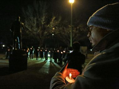 A past year's candlelight vigil was held at the Martin Luther King Jr. Community Center in Dallas. This year's event will go virtual.