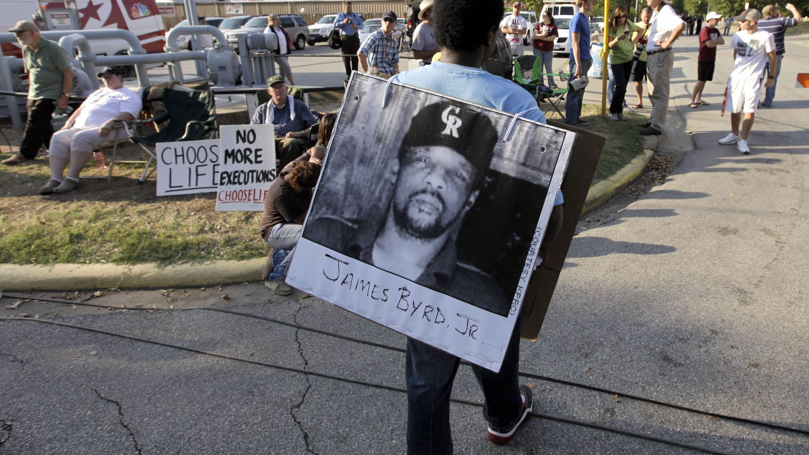Ricky Jason wears a photograph of James Byrd Jr. outside the Texas Department of Criminal Justice Huntsville Unit before the September 2011 execution of Lawrence Russell Brewer in Huntsville. Brewer was the first man executed for killing James Byrd Jr., and John William King is expected to be put to death Wednesday.