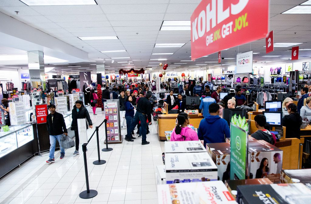 Customers line up to check out during Black Friday shopping at Kohl's in Plano.
