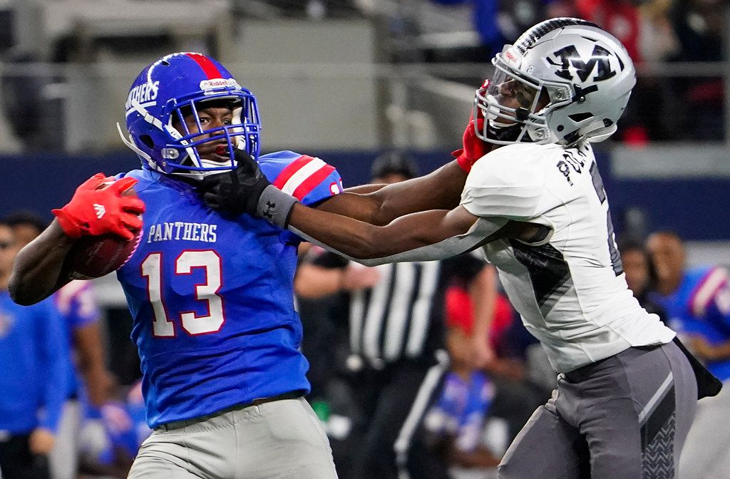 Duncanville wide receiver Roderick Daniels (13) is brought Arlington Martin defensive back KJ Polk, Jr., on a 66 yard run during the second half of a Class 6A Division I Region I semifinal playoff football game at AT&T Stadium non Friday, Nov. 29, 2019, in Arlington. (Smiley N. Pool/The Dallas Morning News)