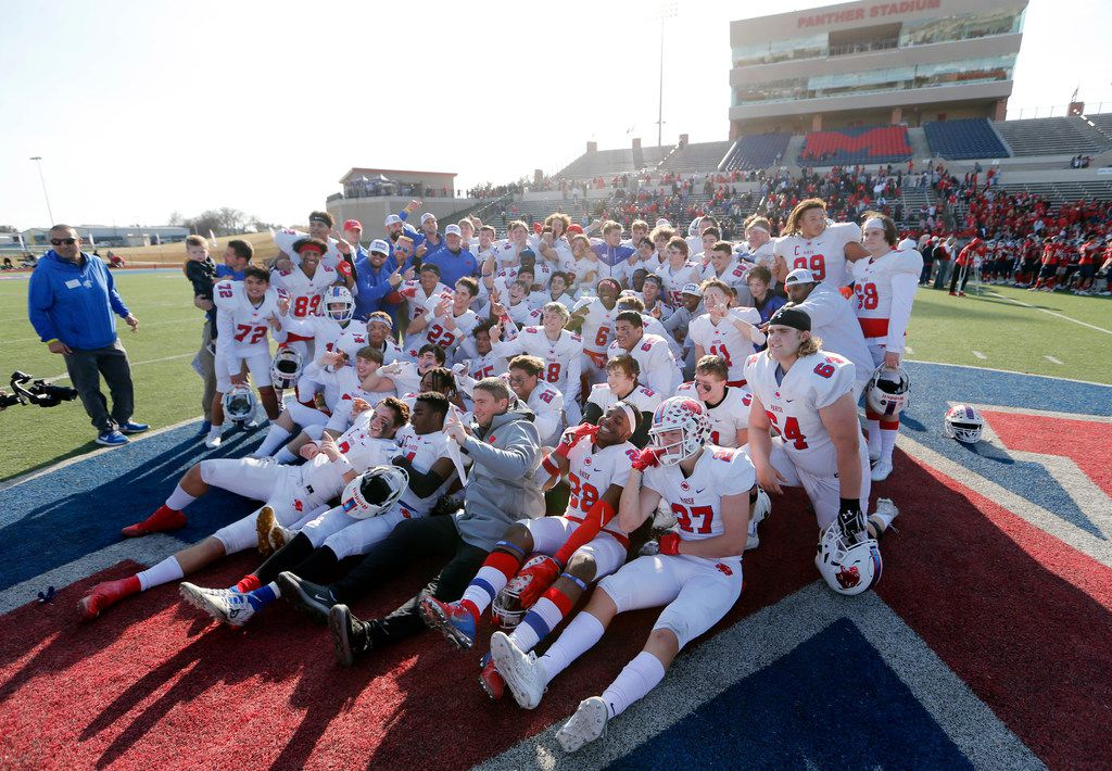 Parish Episcopal football team poses for a portrait on the field after defeating Plano John Paul II 42-14 in the TAPPS Division I State Championship game at Waco Midway's Panther Stadium in Hewitt, Texas on Friday, December 6, 2019. (Vernon Bryant/The Dallas Morning News)
