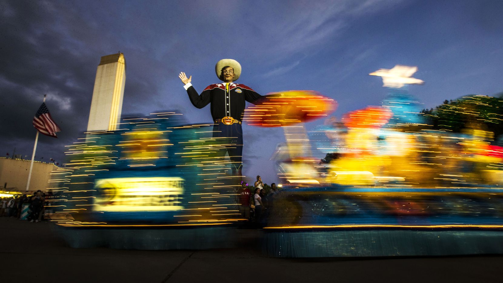 Floats roll past Big Tex during the Starlight Parade at the State Fair of Texas in Dallas on Sept. 30, 2018.