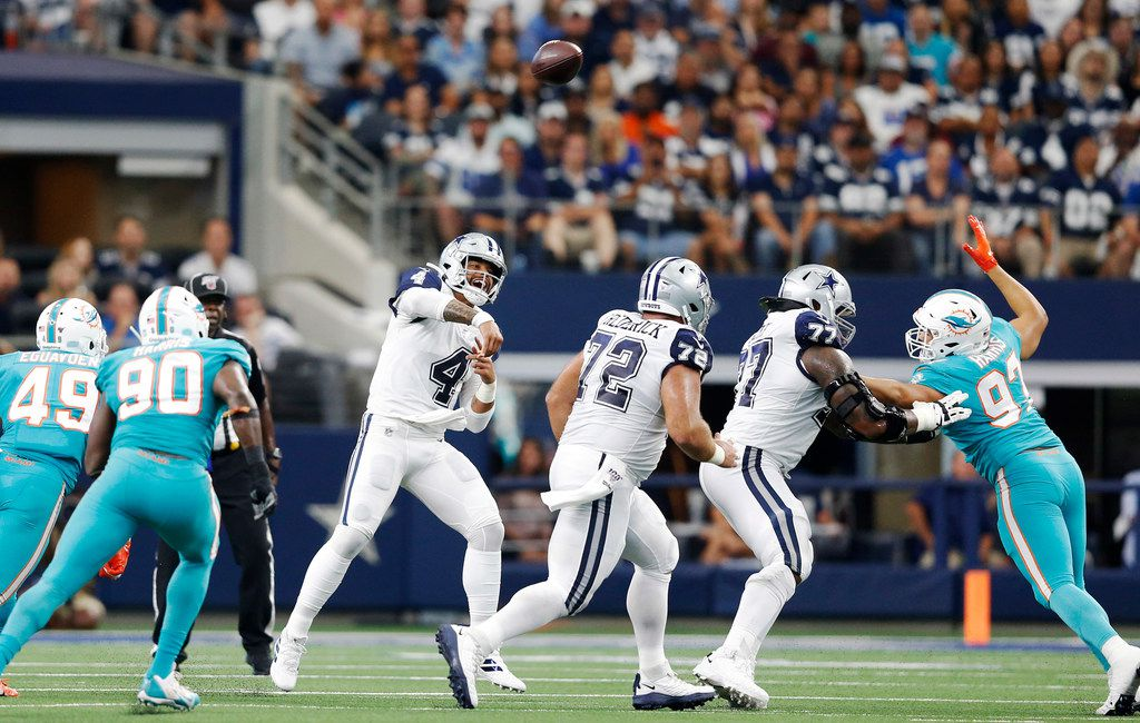 Dallas Cowboys quarterback Dak Prescott (4) attempts a pass in a game against the Miami Dolphins during the first half of play at AT&T Stadium in Arlington, Texas on Sunday, September 22, 2019. (Vernon Bryant/The Dallas Morning News)