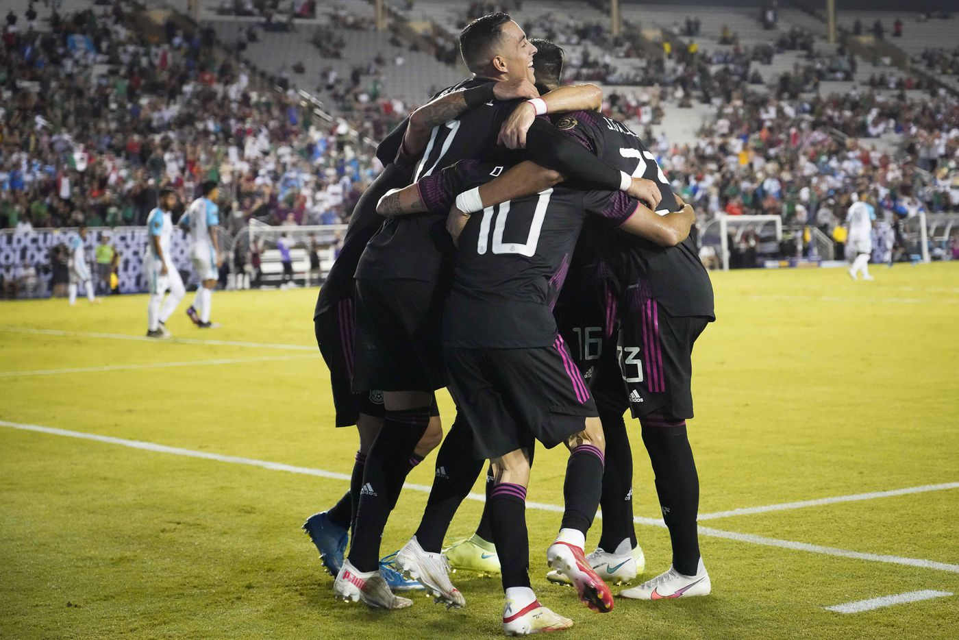 Mexico forward Rogelio Funes Mori (11) joins teammates in celebrating a goal by midfielder Orbelin Pineda (10) during the second half of a CONCACAF Gold Cup Group A soccer match against Guatemala at the Cotton Bowl on Wednesday, July 14, 2021, in Dallas.