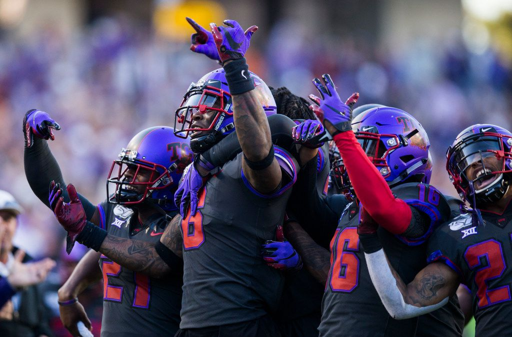 TCU Horned Frogs celebrate during the fourth quarter of an NCAA football game between the University of Texas and TCU on Saturday, October 26, 2019 at Amon G Carter Stadium in Fort Worth.