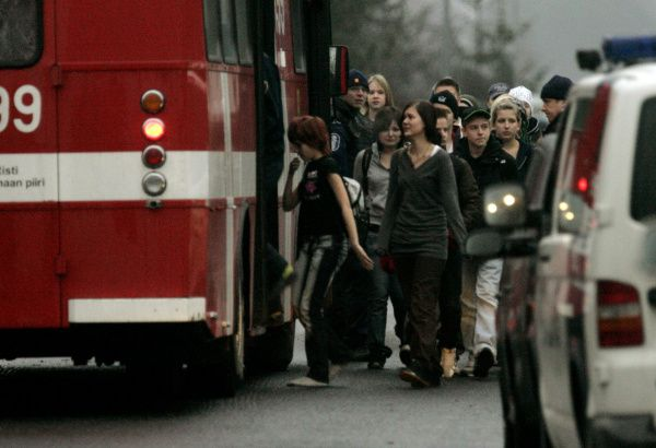 Students board a bus after being evacuated from the Jokela High School on Nov. 7, 2007, in Tuusula, Finland. Pekka-Eric Auvinen killed eight people and wounded ten before killing himself.