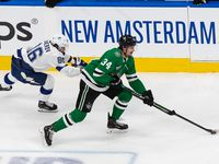 Denis Gurianov (34) of the Dallas Stars battles against Nikita Kucherov (86) of the Tampa Bay Lightning during Game Six of the Stanley Cup Final at Rogers Place in Edmonton, Alberta, Canada on Monday, September 28, 2020.