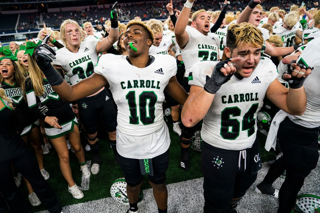 Southlake Carroll football players and cheerleaders celebrate after a 37-15 win over DeSoto in a Class 6A Division I area-round high school football playoff game between Southlake Carroll and DeSoto on Friday, November 22, 2019 at AT&T Stadium in Arlington. (Ashley Landis/The Dallas Morning News)
