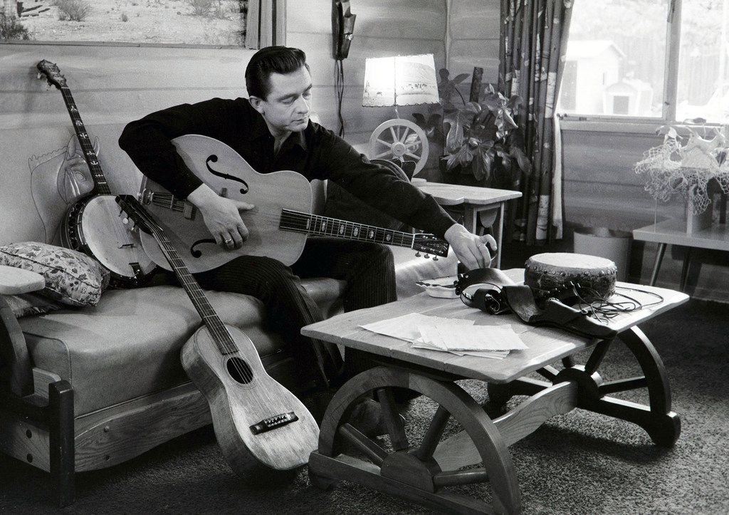 """Ken Burns presents his 16-hour documentary on """"Country Music"""" premiering Sunday on PBS.  One of the artists featured in the series is Johnny Cash, seen at his home in California, 1960. (Handout/TNS)"""