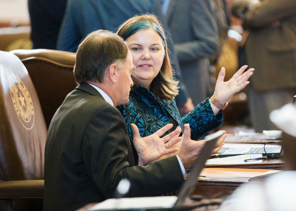 State Rep. Michelle Beckley talks with a colleague on the second day of the 86th Texas legislature on January 9, 2019 at the Texas Capitol.