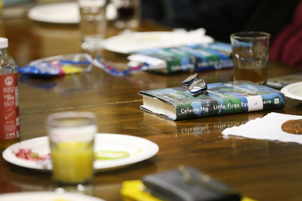 """Copies of """"Little Fires Everywhere"""" by Celeste Ng lay on the table during the Multicultural Women's Book Club meeting at the Dallas Institute of Humanities and Culture in Dallas on Tuesday night, Nov. 27, 2018. (Rose Baca/The Dallas Morning News)"""