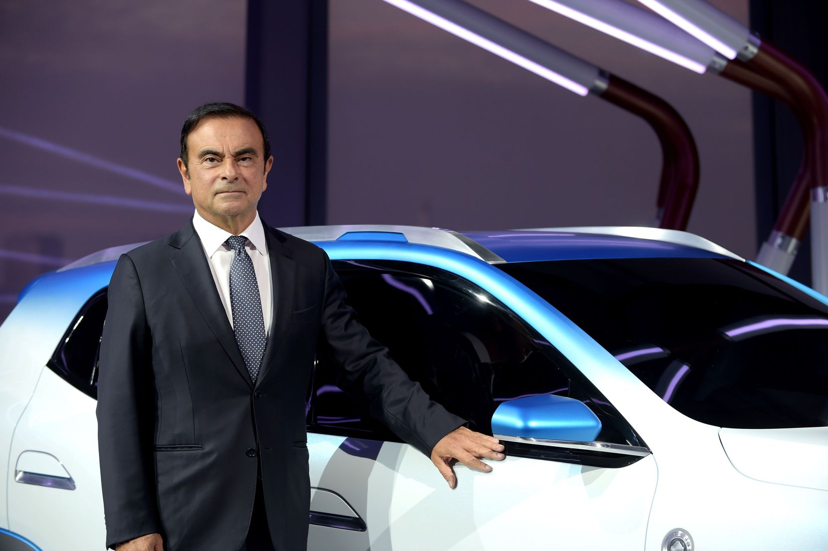 In a 2018 file photo, then chairman and CEO of Renault-Nissan-Mitsubishi Carlos Ghosn presented the Renault K-ZE for the Chinese market at the Paris Motor Show.