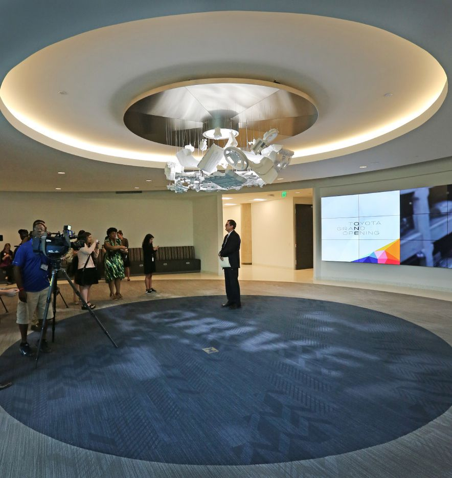 Toyota's Doug Beebe gives the media a tour of the facility at the grand opening of the Toyota headquarters in Plano.