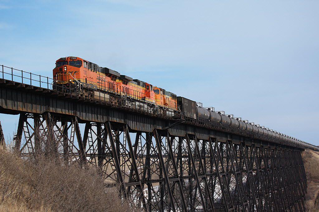 A BNSF train of oil tanker cars crosses a testle west of Minot, N.D. 06092013xBIZ